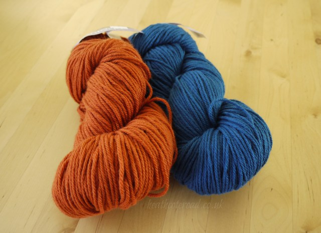 Skeins of Berocco Vintage yarn, orange and blue