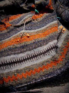 GreyScape jumper in progress. Top down. Suspended set in sleeves. Made up Fair Isle.