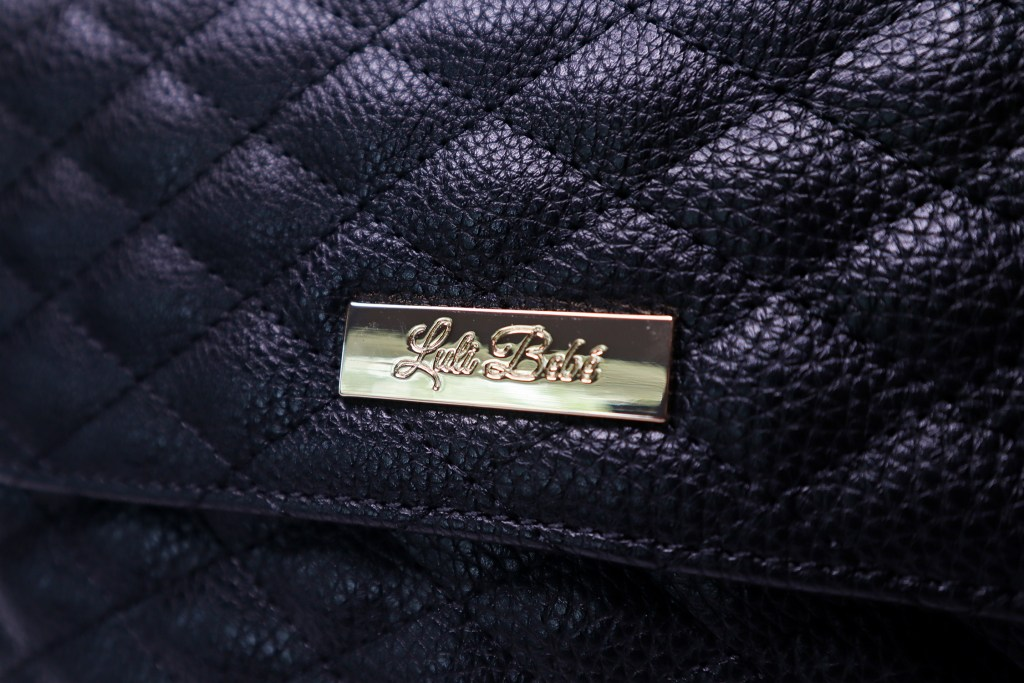 Golden logo on backpack pocket