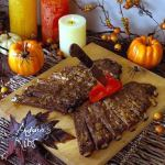 Dead Man's Halloween Ribs on cutting board on party food table