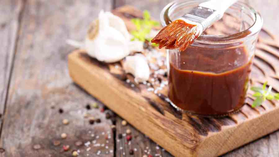 Keto & Low-Carb BBQ Sauce on the counter with brush.