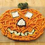 Halloween veggie tray on wooden cutting board