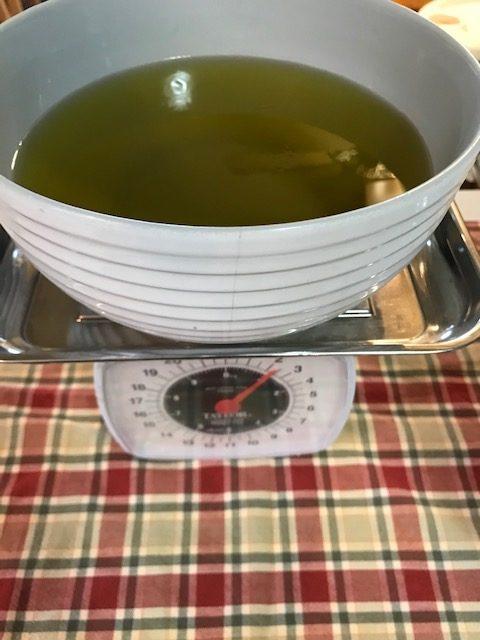 Measuring olive oil to make lye soap