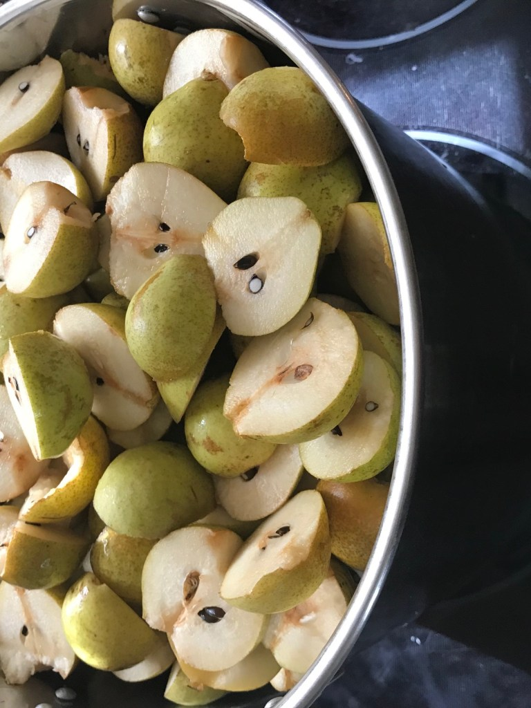 halved pears in a pot