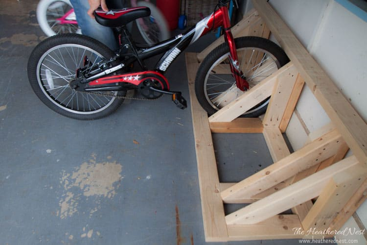 Build a homemade bike rack to help organize your garage