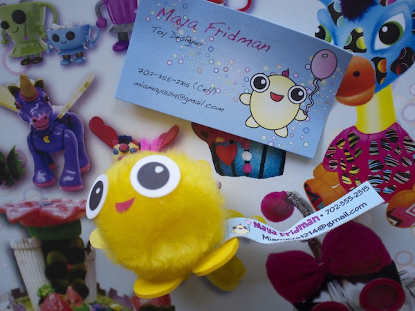 Maya Fridman's toy design business card and promotional material