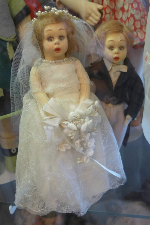 Antique Bride and Groom Doll on display at Angel's Attic Museum