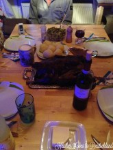 A very dark picture of Christmas dinner.