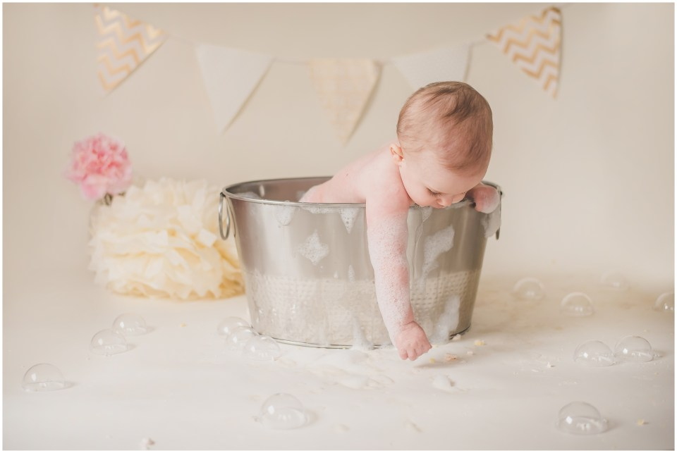 south jersey children photographer, neutral, baby girl, first birthday, ivory gold blush cake smash, after splash