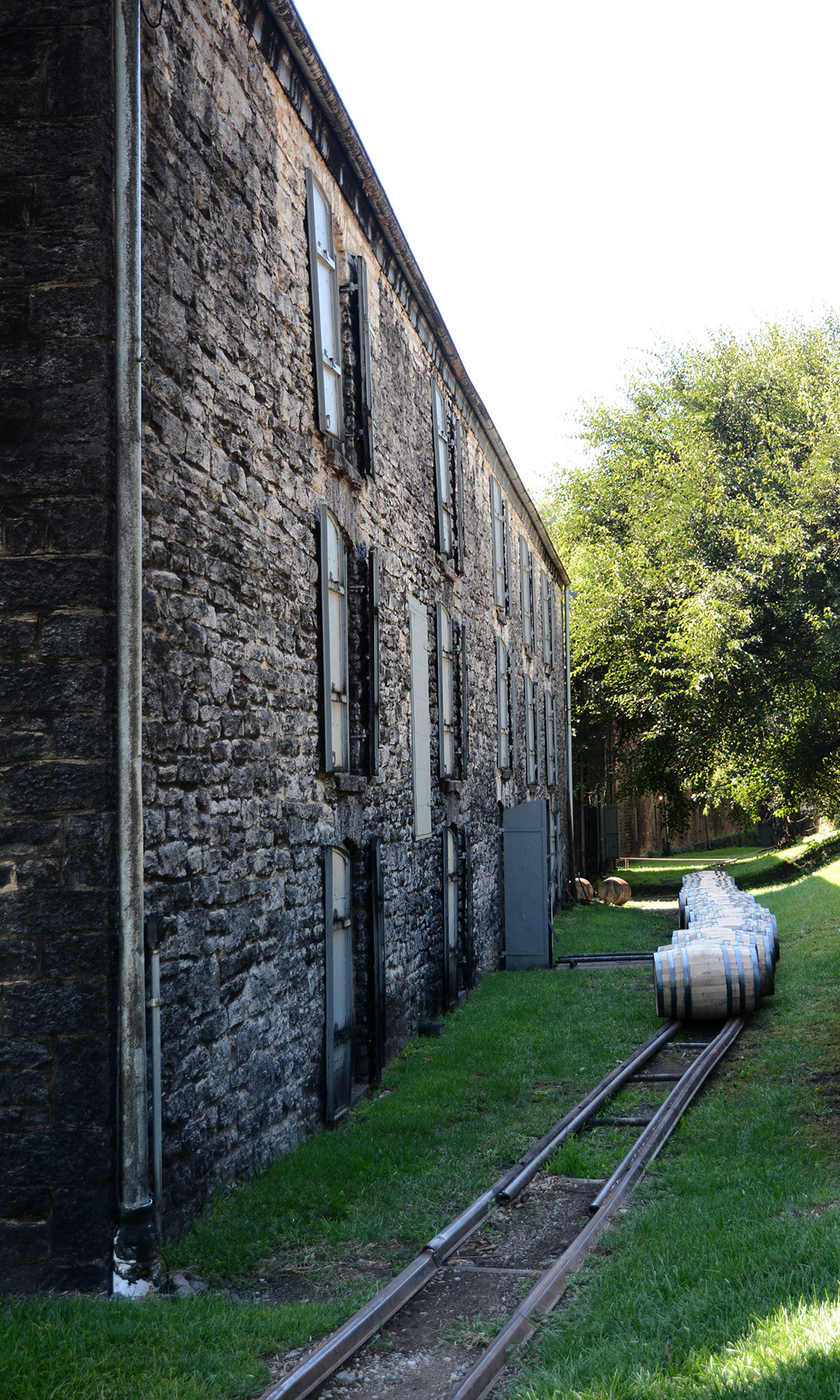 Woodford Reserve grounds where the barrels of bourbon are wheeled on train tracks into storage