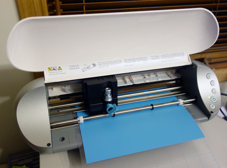 Silhouette Portrait die cut machine with open hood while die cutting