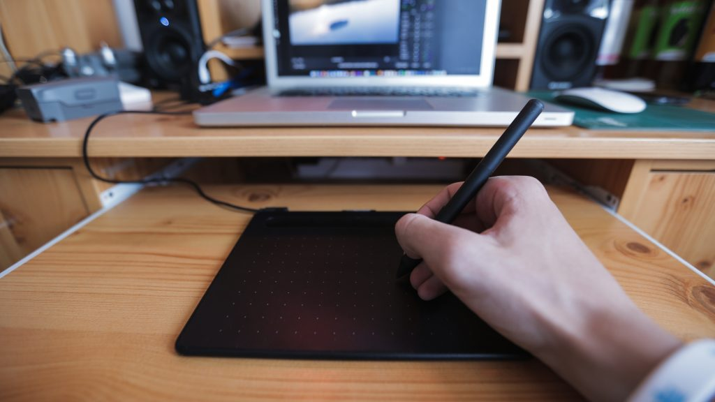 a person using drawing tablet