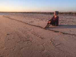 Writing my dreams in the sand for the ocean to envelope