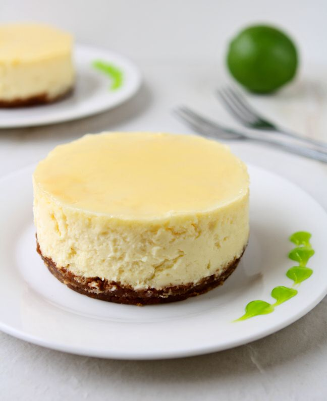 Coconut Cheesecake with Lime Glaze | Smooth coconut cheesecake covered with a refreshing lime glaze baked over a sweet graham cracker crust. Tropical bliss! | heavenlyhomecooking.com
