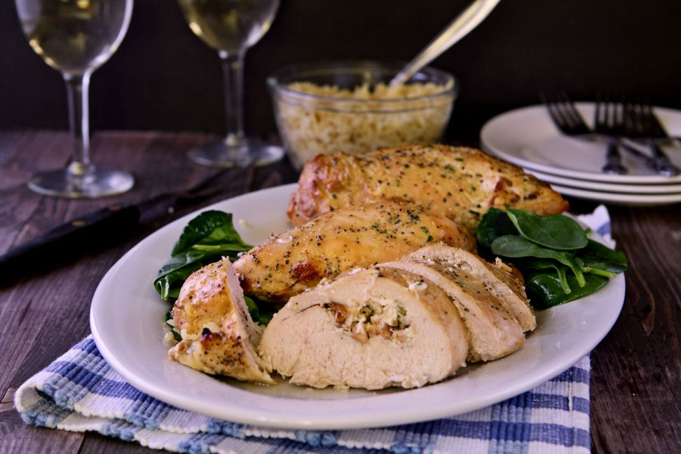 Garlic and Herb Stuffed Chicken Breast | Chicken breast stuffed with vegetable herb cream cheese, garlic and toasted pine nuts. An easy weeknight entree! | heavenlyhomecooking.com