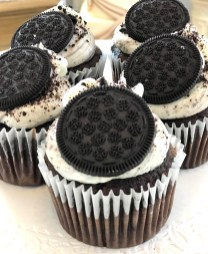Cookies & Creme; Chocolate cake with cookies and cream icing, kissed with white and chocolate icing, topped with a chocolate cookie