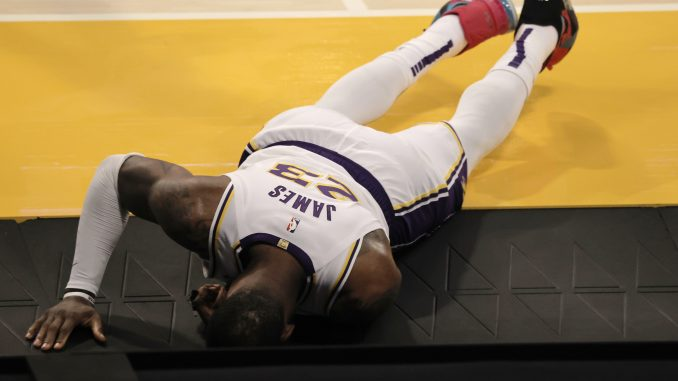 LeBron James of Lakers reacts after injuring his ankle against the Hawks Saturday night.