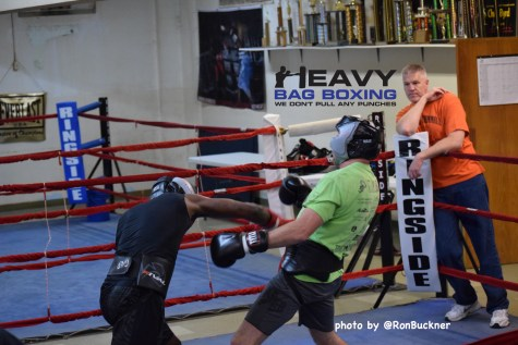 "Jordan Shimmell avoids a punch while sparring Paul ""Pay Per View"" Parker while trainer Dennis Shimmell looks on."