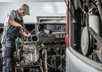 Mechanic is repairing a diesel engine