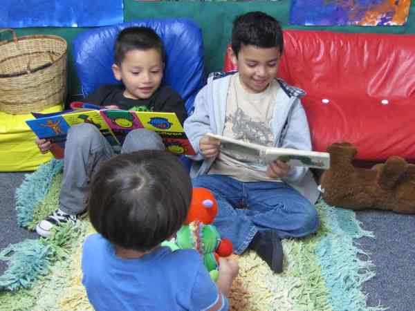 Kids Reading in Library Center