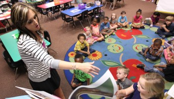 Kindergarten teacher Haley Stewart teachers reads to her students at Parkway Elementary in Tupelo, Miss. (Adam Robison, Northeast Mississippi Daily Journal)