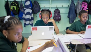 Fifth graders Aiyanah Tyler, Trinity Coker and Hakim Walker work with 13-inch Apple MacBooks from late 2009 running Mac OS 10.8.5 at James G Blaine K-8 school in Philadelphia Monday, June 2, 2014. (John Brecher / NBC News)