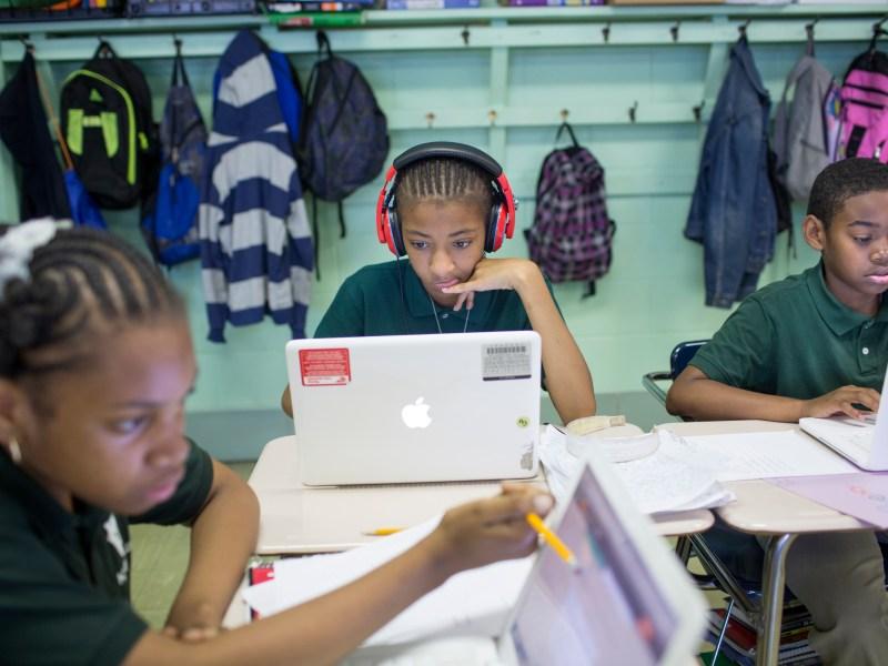 Fifth graders Aiyanah Tyler, Trinity Coker and Hakim Walker work with 13-inch Apple MacBooks from late 2009 running Mac OS 10.8.5 at James G Blaine K-8 school in Philadelphia Monday, June 2, 2014. (John Brecher / NBC News)