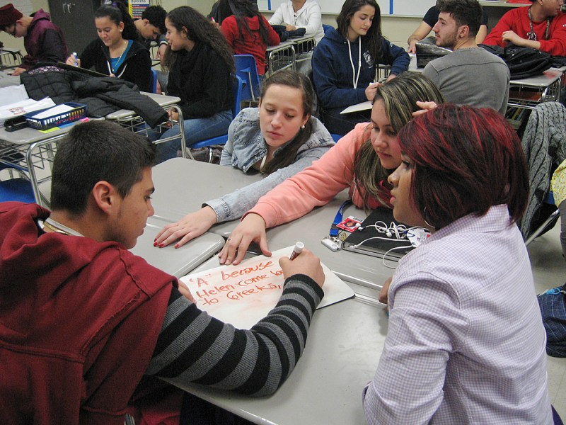 The measured achievement gap between the students in this Revere High School English as a Second Language class and their English-speaking peers is likely to balloon with the introduction of the PARCC exam. From left, clockwise, are Mateo López and Nataly Gómez, both from Colombia; Amanda Moreira, from Brazil; and Maria Hernández, from Honduras.