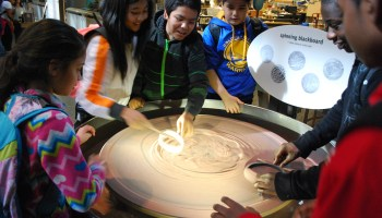 "Franklin Middle School students from Vallejo, Calif., experiment with a ""spinning blackboard"" while on a field trip to San Francisco's Exploratorium."