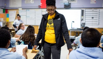 "Mara Flores Schustack helps a group of her seventh grade English students at Elmhurst Community Prep in Oakland, California. ""This job does not get boring,"" she said to explain one reason she would be starting her ninth year at the school this fall."