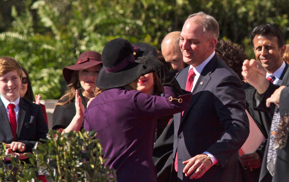 John Bel Edwards hugs his wife after taking the oath of office as Louisiana governor on the steps of the Louisiana Capitol in Baton Rouge, La., Monday, Jan. 11, 2016. Edwards is Louisiana's 56th governor.