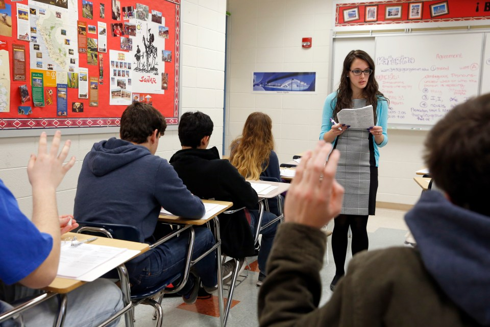 Students hold their hands up as Katerina Maylock, with Capitals Educators, teaches a test preparation class at Holton Arms School, Sunday, Jan. 17, 2016 in Bethesda.