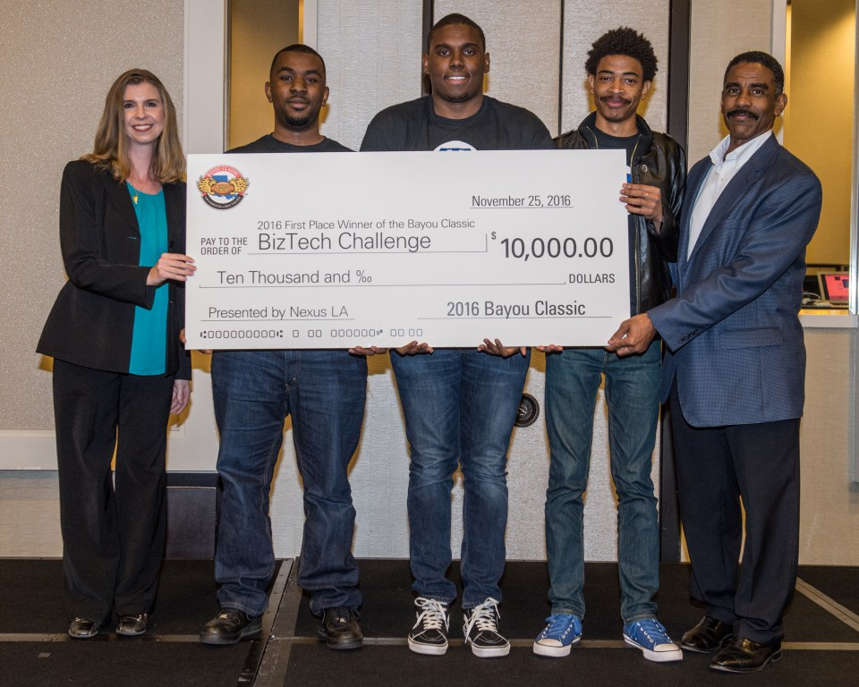 The winning team from Grambling State University pitched Relief Front, the online marketplace that sells products of other stores that are negatively impacted by natural disasters, which earned them $10,000 in capital and $5,000 in free legal services for the BizTech Challenge at the Bayou Classic. Byron Clayton and Genevieve Silverman of Nexus Louisiana bookend the winning team.
