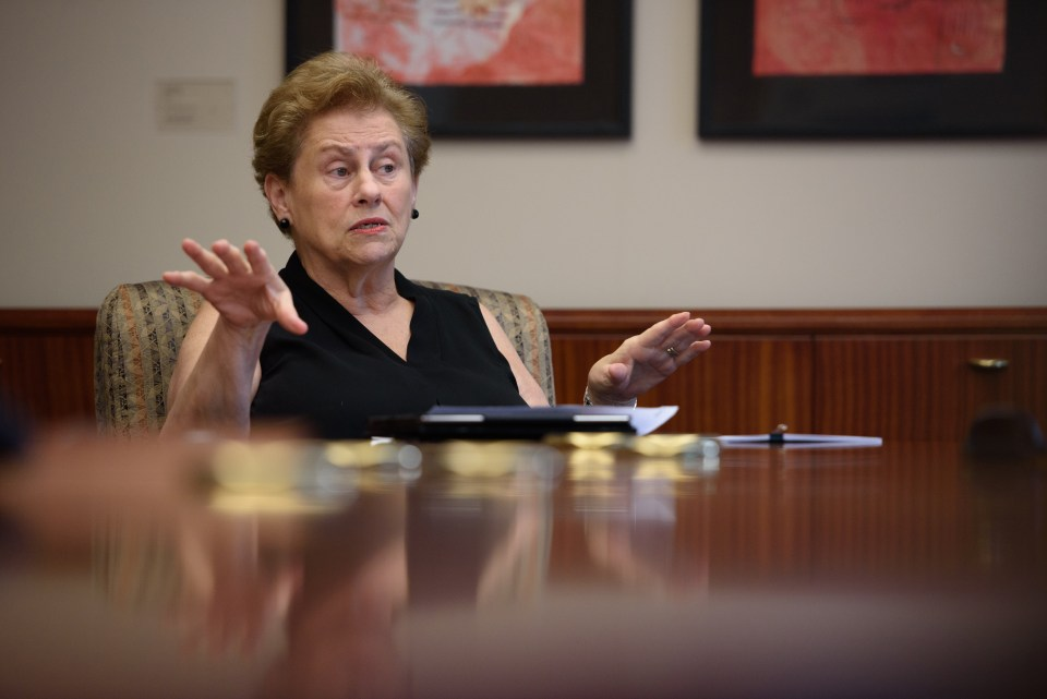 A former bank executive, Helen Drinan, took over as president of Simmons College to discover the university couldn't make payroll. She has since used revenue from graduate programs to help restore financial health, an increasingly common strategy in higher education.