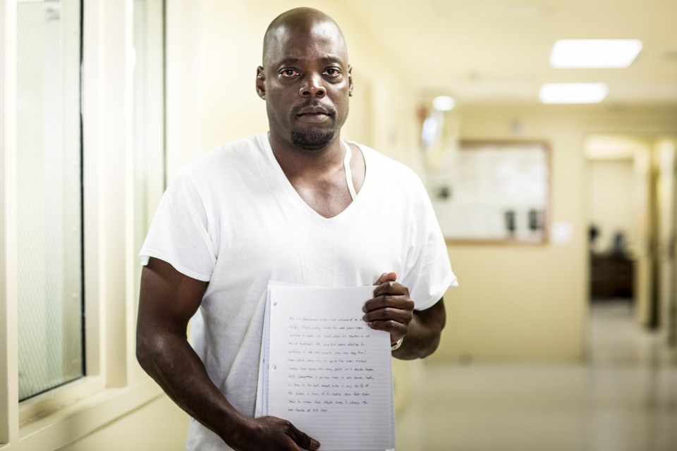 """San Quentin inmate Anthony Anderson holds the essay he wrote, addressing future students in the program's English classes. """"Take pride in getting an education,"""" he wrote. """"You will have something to offer to society. Who knows you may be the next big thing in literature."""""""