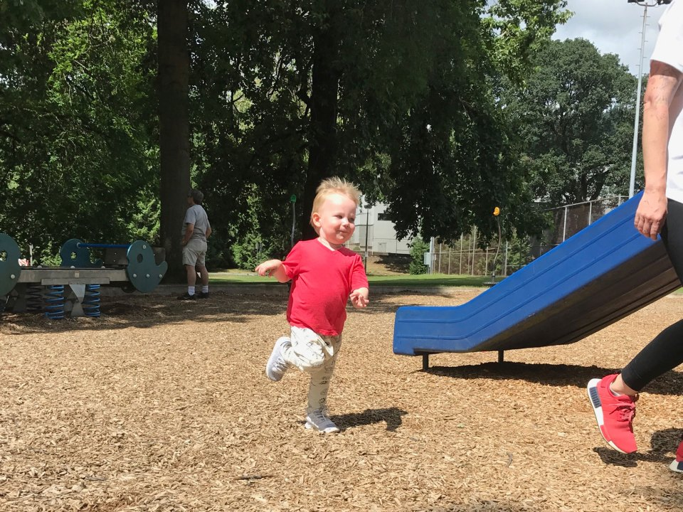 Everett Duncan, 2, runs behind his mother at a park in Portland, Ore. Running is a skill most kids master by the end of their 2-year-old year.