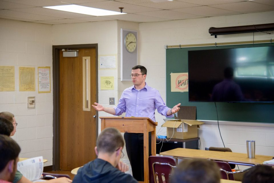 Ray Mertz, a Meadowbrook High School social studies teacher, is using a school-provided grant to pay for a master's degree, which will allow him to teach college-level political science courses to local students.