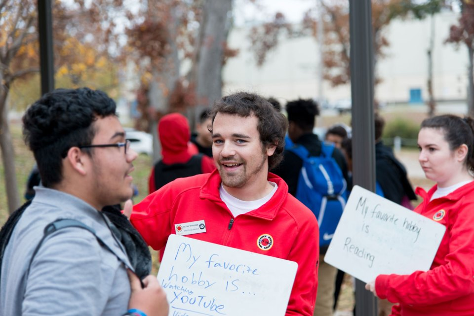 City Year member Shawn Wiyninger greets a student at Webster High School.