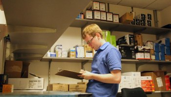 Peter O'Halloran checks supplies at his job. O'Halloran works full-time at a nonprofit in Philadelphia.