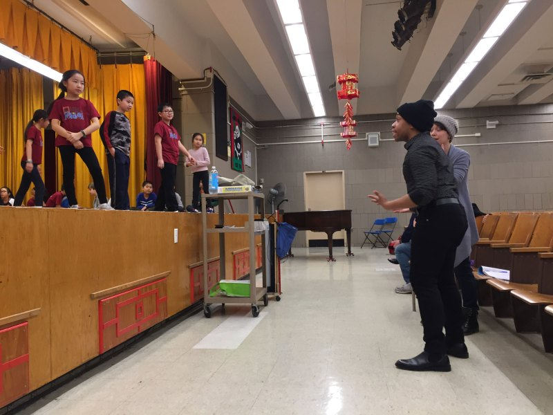 Instructors Kyle Garvin and Hannah Balagot, both professional theater performers, teach choreography to students at Yung Wing School.