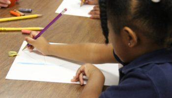 A preschool student in class.