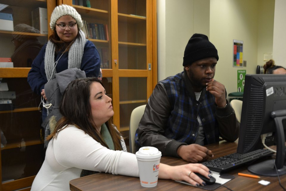 Laquon Jackson receives help from his Introduction to the Health Care Professions instructor, Elizabeth Dalianis.