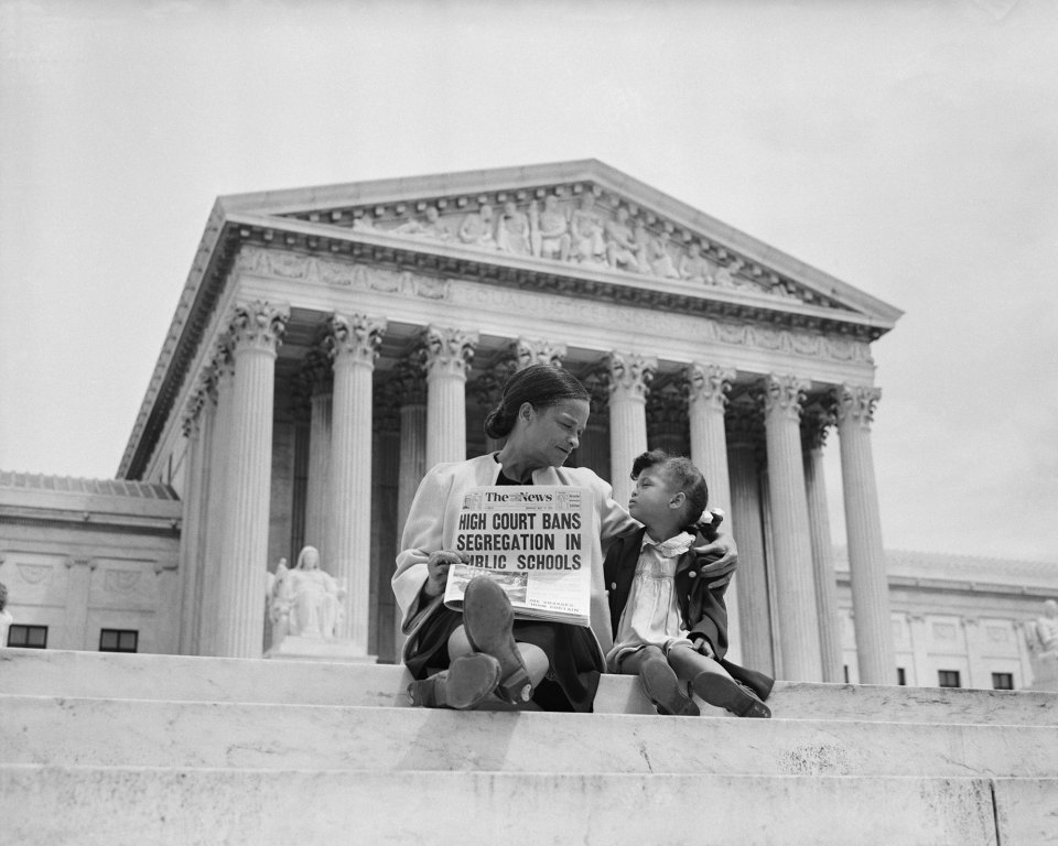 Nettie Hunt and her daughter Nickie sit on the steps of the U.S. Supreme Court. Nettie explains to her daughter the meaning of the high court's ruling in the Brown Vs. Board of Education case that segregation in public schools is unconstitutional.