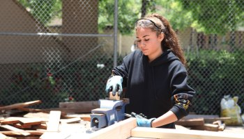 Alana Johnson, 18, uses a workbench vise during a construction class at Abraxas Continuation High School, in Poway, California. Johnson enrolled in an all- girls construction class at the school last year and has since completed three advanced mixed-gender construction courses.