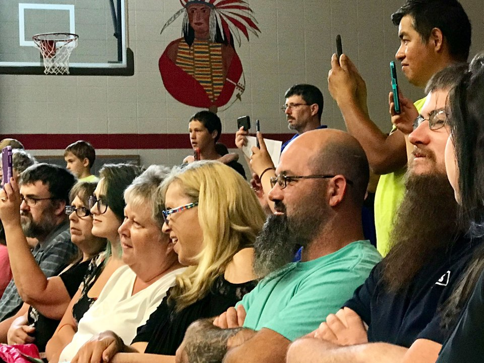 Family members of Child Care Network Preschool students look on with pride during pre-K graduation at Emerson Elementary School in Seymour, Indiana.