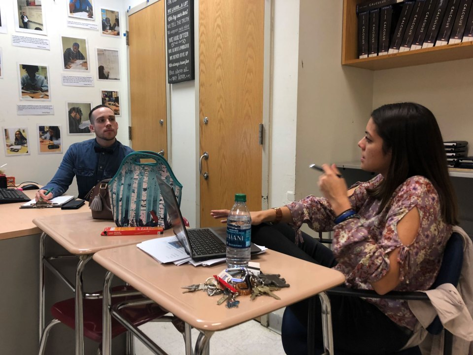 Angel Rivera and Sara Caro, humanities teachers at the Urban Assembly School for Applied Math and Science in the Bronx, meet to plan a lesson on World War II history lesson together.