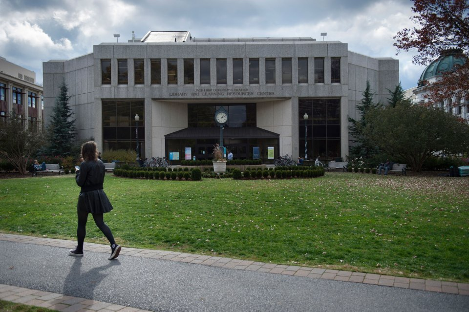 A student walks past the Bender Library on the American University campus in Washington, D.C. American is one of 32 colleges and universities with an accelerated program that lets students earn bachelor's degrees in thee years instead of four, which one management expert has criticized for helping only undergraduates who are already very well prepared.