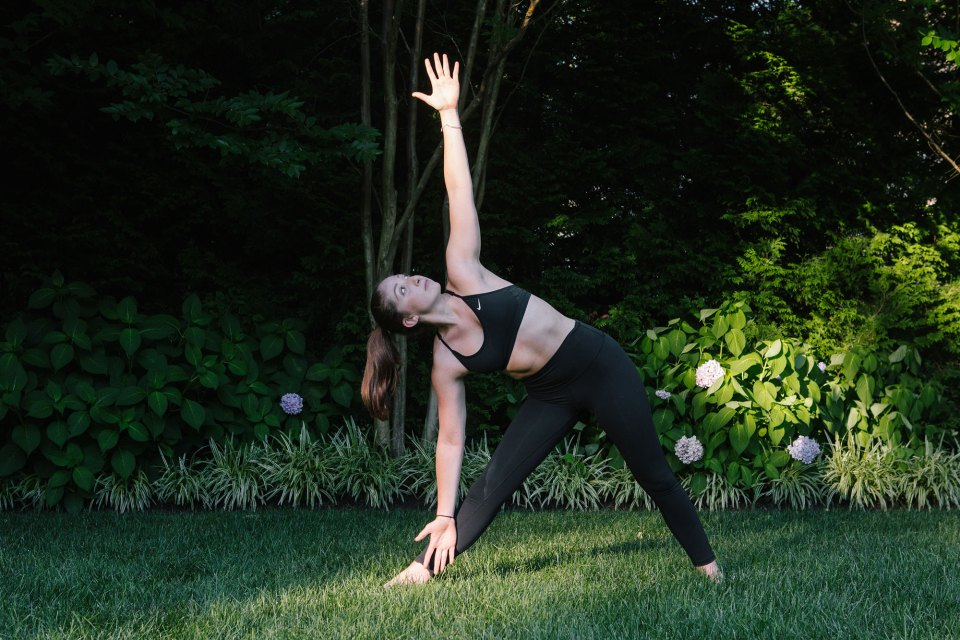 Jackie Brenner, 18, practicing yoga in the yard of a family friend's home in Bryn Mawr, Pa., in July. Through her nonprofit, Piece of Peace, she teaches others how to live healthy lives.