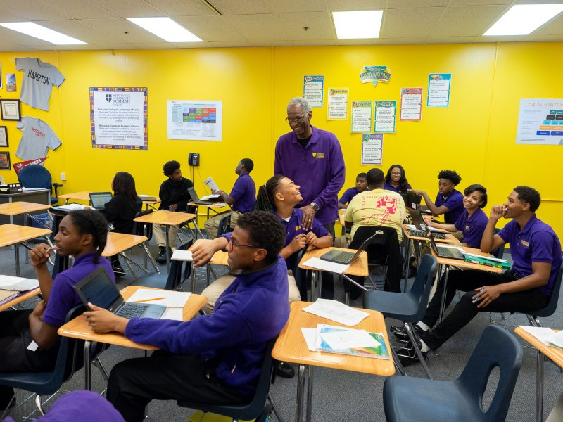 School founder Howard Fuller visits with students at the Milwaukee Collegiate Academy charter school.
