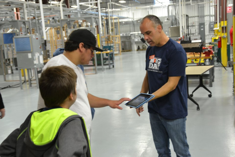 "On ""Manufacturing Day,"" students from Craig High School, in Janesville, Wisconsin, get a lesson in HVAC (heating, ventilation and air conditioning) technology from an instructor at Blackhawk Technical College."
